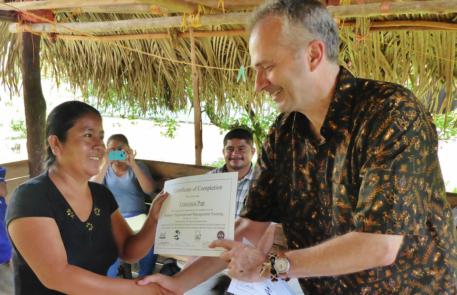 IIED researcher Duncan Macqueen presents a certificate at a women enterprise group in Belize