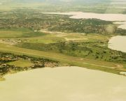 An aerial view of Entebbe airport. The airport is located on the shores of Lake Victoria, close to numerous environmentally sensitive wetland areas (Photo: Niranjanoak, Creative Commons via Wikipedia)