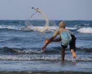 A man casting a net