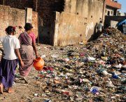 Two women walking in a slum