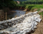 sandbags holding back river water