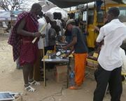 A demonstration of solar PV products by the Energy and Environment Partnership in Tanzania's southern Iringa Region gathers an audience of all ages (Photo: EEP Southern and Eastern Africa, Creative Commons via Flickr)