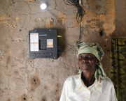 Sixty-two-year-old Elizabeth Mukwimba has a solar-powered lighting system. She no longer has to buy expensive kerosene and has been able to use the savings to re-roof her house (Photo: Russell Watkins/Department for International Development)