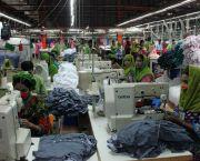 Women work in a knitwear factory