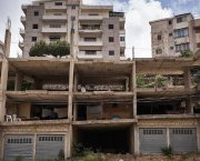 A block of unfinished buildings, open to the elements