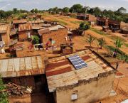 This 500W solar system in a rural village in Uganda powers a home, a public broadcasting system, a barbershop and a video hall (Photo: SolarNow via USAID, Creative Commons via Flickr)