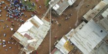 An aerial view of people in an informal settlement