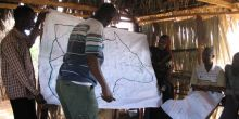 Maps drawn by community groups before being transferred to a geo-referenced satellite map projected on a wall (Photo: James Pattinson)