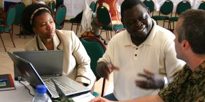 Isilda Nhantumbo, Bright Sibale, and Duncan Macqueen exchange ideas at a Forest Governance Learning Group Learning Event in Mozambique. Photo: Leianne Rolington