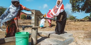 Women collecting clean water at a water pump