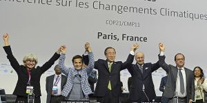 COP21 president Laurent Fabius (second right) and UNFCCC executive secretary Christiana Figueres (second left) celebrate the Paris Agreement (Photo: UNclimatechange, Creative Commons via Flickr)