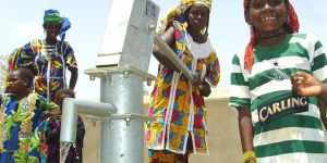 Children using water pump in Burkina Faso