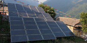 A large solar panel with Nepalese mountains in the background