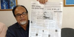 Shahajat Ali shows a newspaper article describing the incentive-based hilsa conservation programme under the Department of Fisheries (Photo: BCAS)