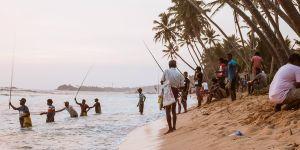 Men fishing on the beach in Unawatuna, Sri Lanka