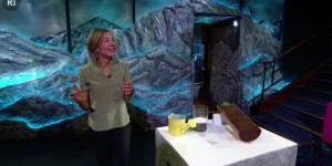 Dr Tara Shine conducts an experiment for her televised lecture