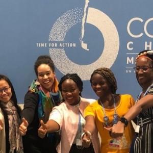 Smiling women gathering at COP25