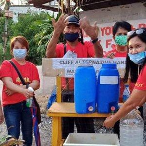 A group of people at a handwashing facility