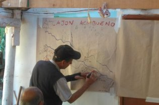 A man drawing a map