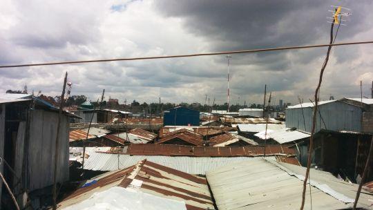 View over the Mukuru informal settlement in Nairobi, showing corrugated roofs