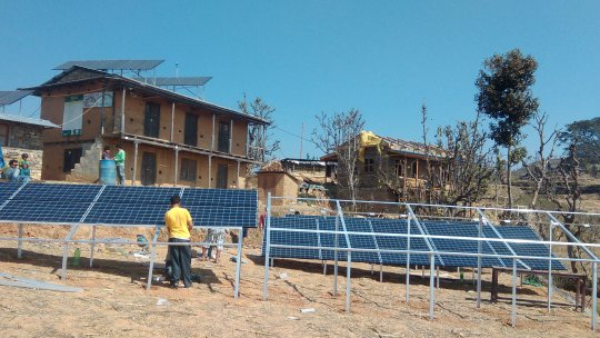 People putting up solar panels
