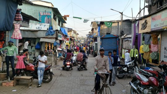 A busy side street in the settlement of Dharavi