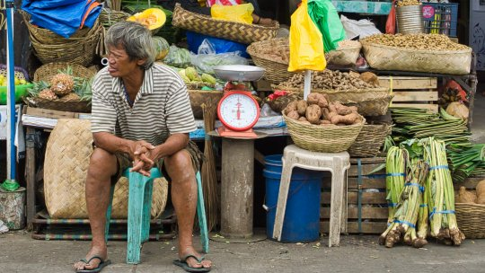 A stallholder in front of a food stall