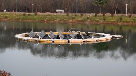 Solar panels on a lake.