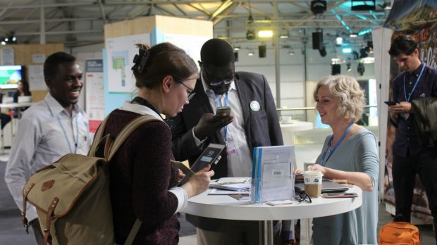 IIED communications senior coordinator Julie Hill talks to COP23 delegates in Bonn, Germany