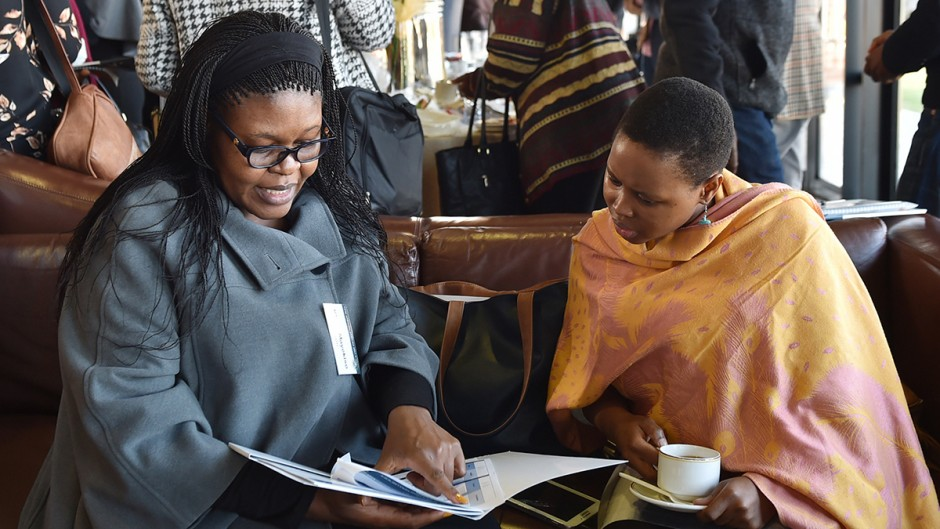 Two women looking at a report